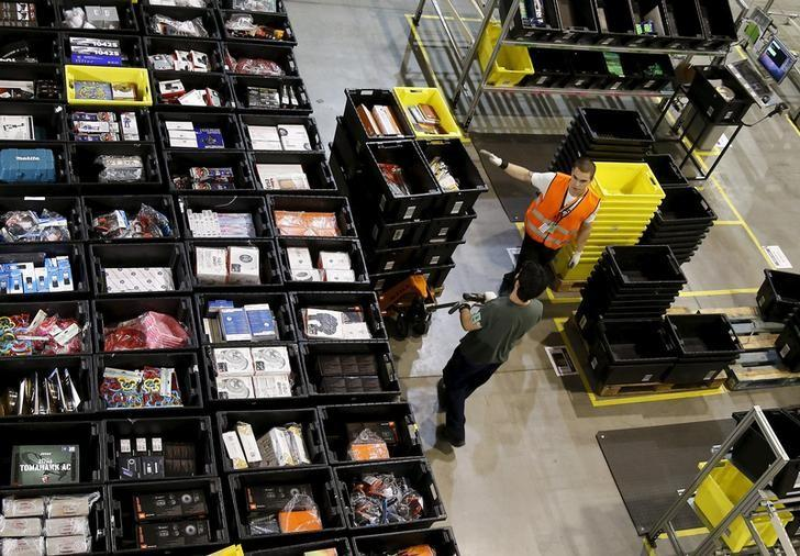 People work during Black Friday deals week at an Amazon fulfillment centre in Madrid, Spain, November 24, 2015. REUTERS/Andrea Comas/Files