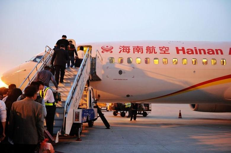People board a plane of HNA Group in Qingdao, Shandong province, China, October 17, 2016. Picture taken October 17, 2016. REUTERS/Stringer