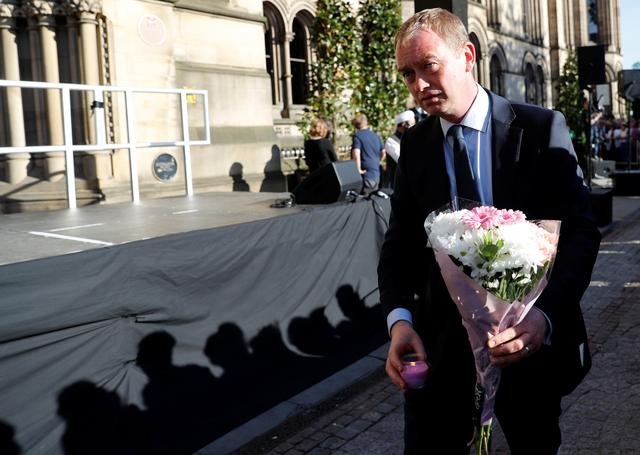 Tim Farron, the leader of Britain's Liberal Democrat Party, takes part in a vigil for the victims of an attack on concert goers at Manchester Arena, in central Manchester, Britain May 23, 2017. REUTERS/Darren Staples