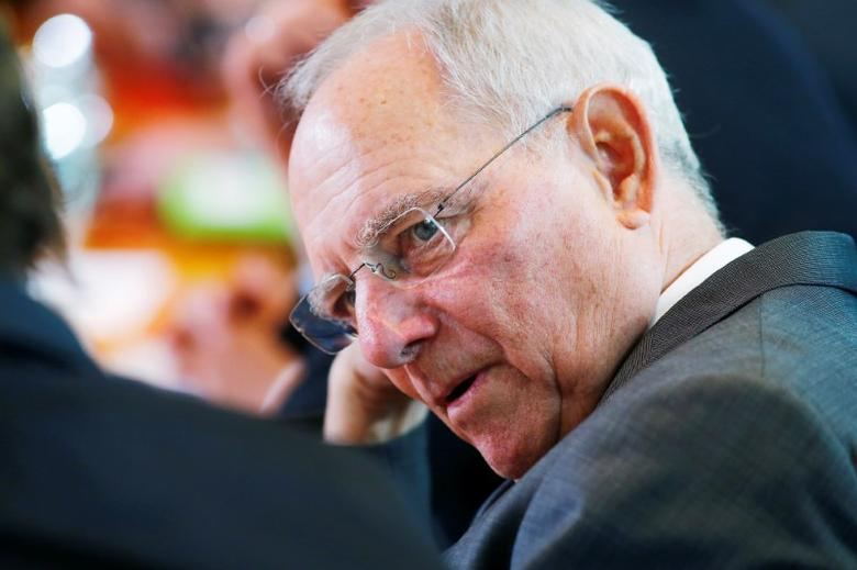 FILE PHOTO: German Finance Minister Wolfgang Schaeuble attends the weekly cabinet meeting at the Chancellery in Berlin, Germany April 12, 2017. REUTERS/Hannibal Hanschke