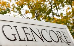 FILE PHOTO - The logo of commodities trader Glencore is pictured in front of the company's headquarters in Baar, Switzerland, September 30, 2015.   REUTERS/Arnd Wiegmann/File Photo