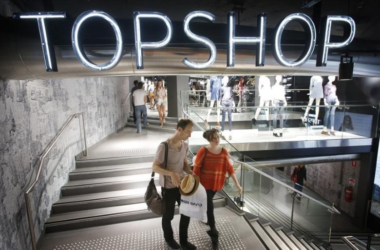 Shoppers exit a Topshop store in Sydney November 19, 2012. REUTERS/Tim Wimborne