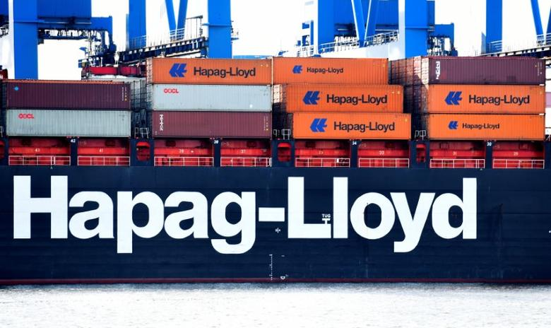 A Hapag Lloyd container ship is loaded at a shipping terminal in the harbour of Hamburg, Germany, March 25, 2017. Picture taken March 25, 2017.  REUTERS/Fabian Bimmer