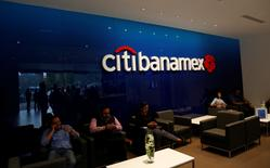 Customers wait to be served by employees inside at a Citibanamex branch in Mexico City, Mexico May 8, 2017. REUTERS/Henry Romero