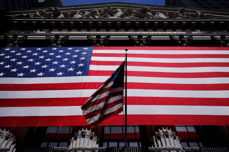 U.S. flags are displayed on the facade of the New York Stock Exchange in New York, U.S., June 1, 2016.  REUTERS/Lucas Jackson
