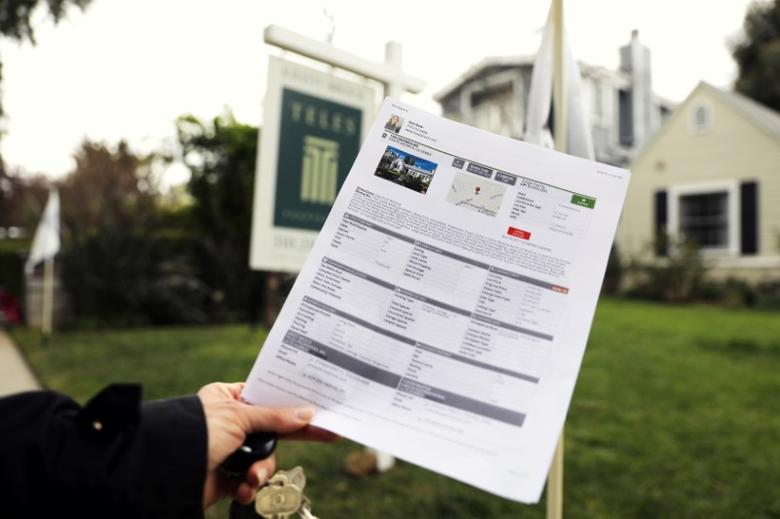 FILE PHOTO --  A woman holds a piece of paper advertising a home for sale in Santa Monica, California, U.S., March 21, 2017. REUTERS/Lucy Nicholson/File Photo