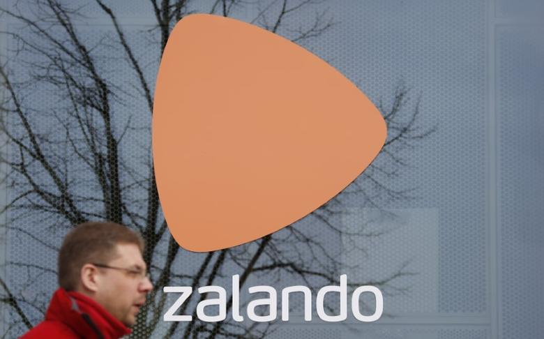 A man walks past the logo of  fashion retailer Zalando in Berlin, Germany,  March 3, 2016.   REUTERS/Fabrizio Bensch
