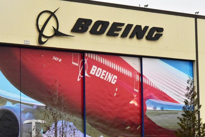Boeing Co's logo is seen above the front doors of its largest jetliner factory in Everett, Washington, U.S. January 13, 2017. REUTERS/Alwyn Scott
