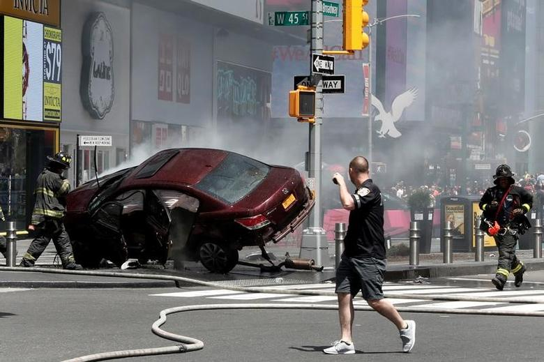 FILE PHOTO: A vehicle that struck pedestrians and later crashed is seen on the sidewalk in Times Square in New York City, U.S., May 18, 2017. REUTERS/Mike Segar