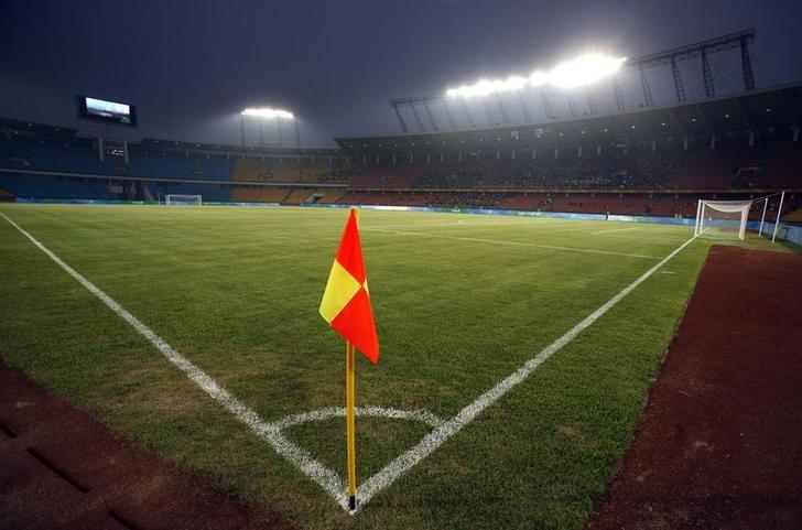 The Worker's Stadium is lit up for a soccer test event in Beijing April 20, 2008.  REUTERS/David Gray/Files