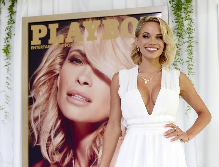 Dani Mathers, 28, the 2015 Playmate of the Year, poses during a luncheon on the garden grounds of the Playboy Mansion in Los Angeles, California May 14, 2015. Mathers, the 56th Playmate of the Year, also receives $100,000 in prize money and a one-year lease on a 2015 Mini Cooper S Convertible in Midnight Black. REUTERS/Kevork Djansezian/Files
