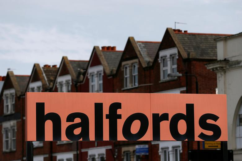 FILE PHOTO: A Halfords sign is seen outside a store in London, Britain April 10, 2016. REUTERS/Stefan Wermuth/File Photo