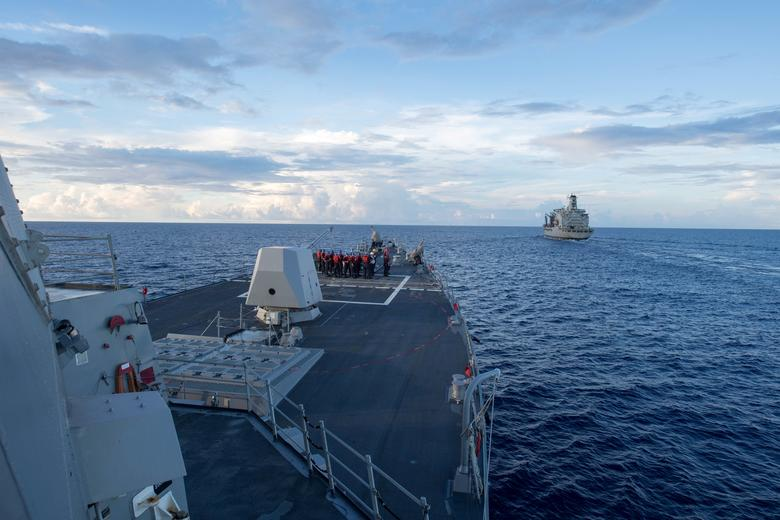The Arleigh Burke-class guided-missile destroyer USS Dewey prepares for a replenishment-at-sea in the South China Sea May 19, 2017. Kryzentia Weiermann/Courtesy U.S. Navy/Handout via REUTERS