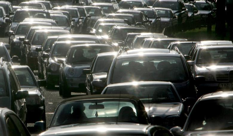 Drivers queue during evening rush hour on the M4 motorway, in west London, July 20, 2004. REUTERS/Toby Melville