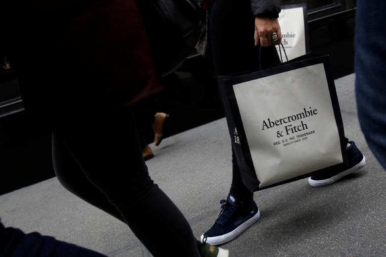 A person carries a bag from the Abercrombie & Fitch store on Fifth Avenue in Manhattan, New York City, U.S., February 27, 2017. REUTERS/Andrew Kelly