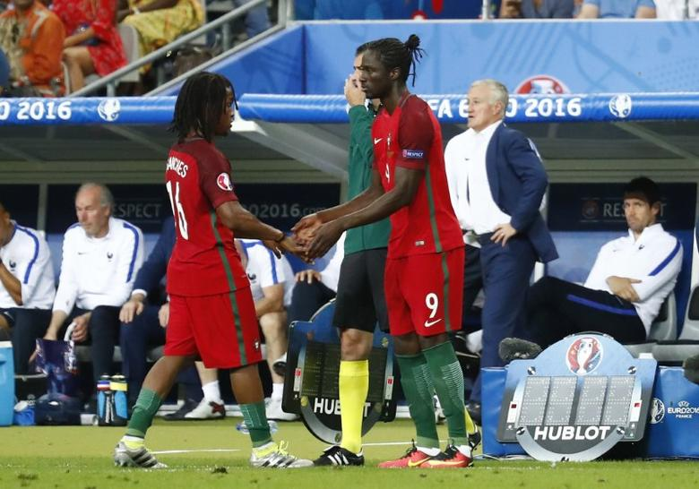 Football Soccer - Portugal v France - EURO 2016 - Final - Stade de France, Saint-Denis near Paris, France - 10/7/16Portugal's Eder is substituted on for Renato Sanches as France head coach Didier Deschamps looks onREUTERS/Michael Dalder/Files
