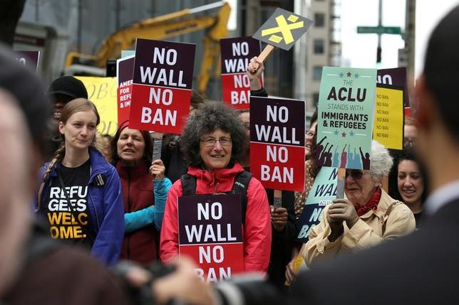 FILE PHOTO: People protest U.S. President Donald Trump's travel ban outside of the U.S. Court of Appeals in Seattle, Washington, U.S. May 15, 2017.  REUTERS/David Ryder