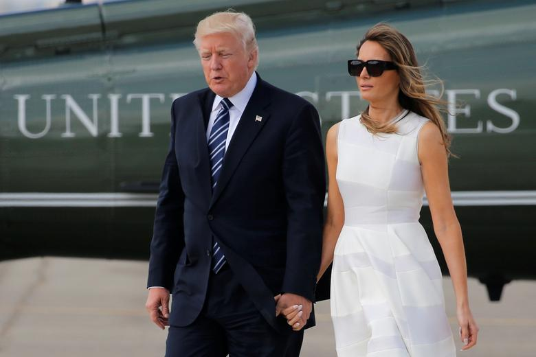 President Donald Trump and first lady Melania Trump hold hands as they arrive to board Air Force One for travel to Rome from Ben Gurion International Airport in Tel Aviv, Israel. REUTERS/Jonathan Ernst