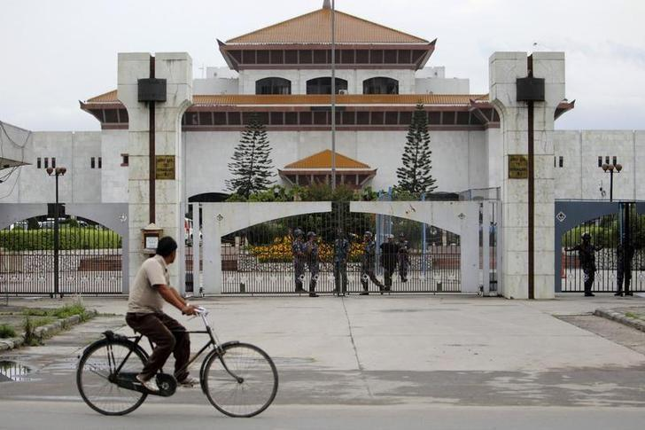 A cyclist passes by the Constituent Assembly building in Kathmandu May 28, 2011. REUTERS/Navesh Chitrakar/Files