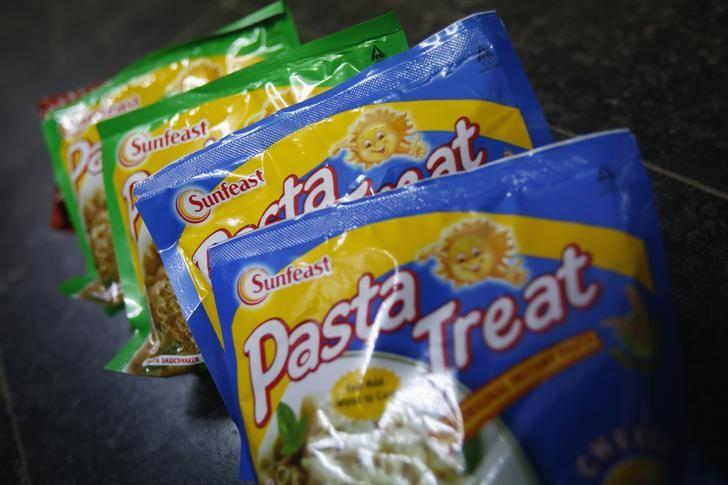 Sunfeast-branded instant past meals, which are part of a line of fast-moving consumer goods owned by Indian cigarette maker ITC, are displayed for sale at a grocery store in Mumbai May 17, 2013. REUTERS/Vivek Prakash/Files