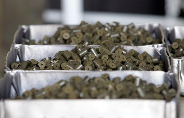 FILE PHOTO: Uranium pellets, a nuclear fuel product for atomic power plants, are seen on a production line at Ulba Metallurgical Plant in Kazakhstan's eastern town of Ust-Kamenogorsk in this August 11, 2006 file photo. REUTERS/Shamil Zhumatov/Files