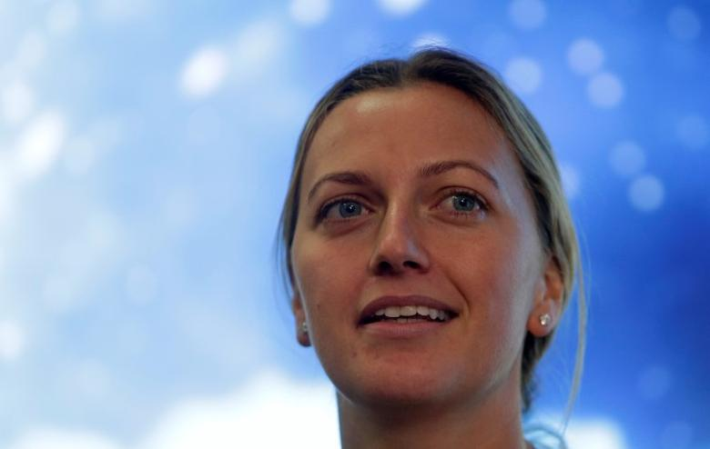 Czech Republic's tennis player Petra Kvitova speaks during a news conference, after she was injured on Tuesday when she fought off an intruder in her home, damaging all the fingers on her playing hand, in Prague, Czech Republic December 23, 2016.    REUTERS/David W Cerny/Files