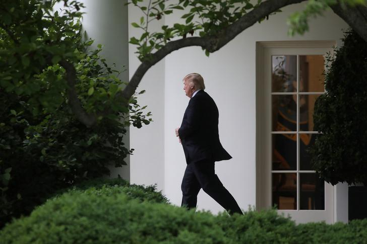 FILE PHOTO: U.S. President Donald Trump leaves the Oval Office of the White House before his departure to New York, in Washington, U.S., May 4, 2017. REUTERS/Carlos Barria