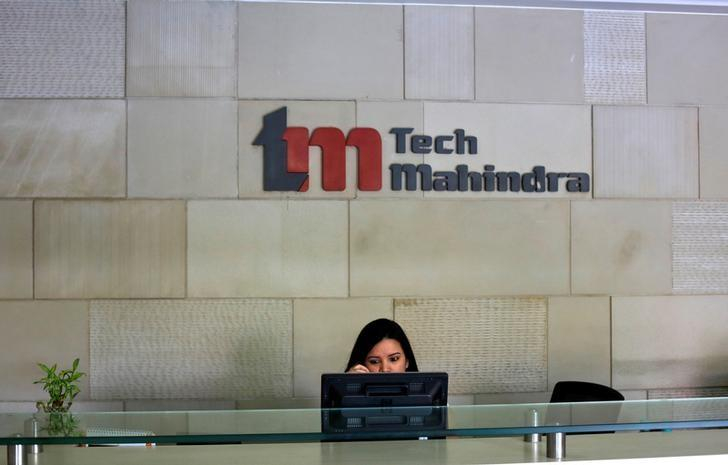 FILE PHOTO -  An employee sits at the front desk inside Tech Mahindra office building in Noida on the outskirts of New Delhi March 18, 2013.  REUTERS/Adnan Abidi/File Photo