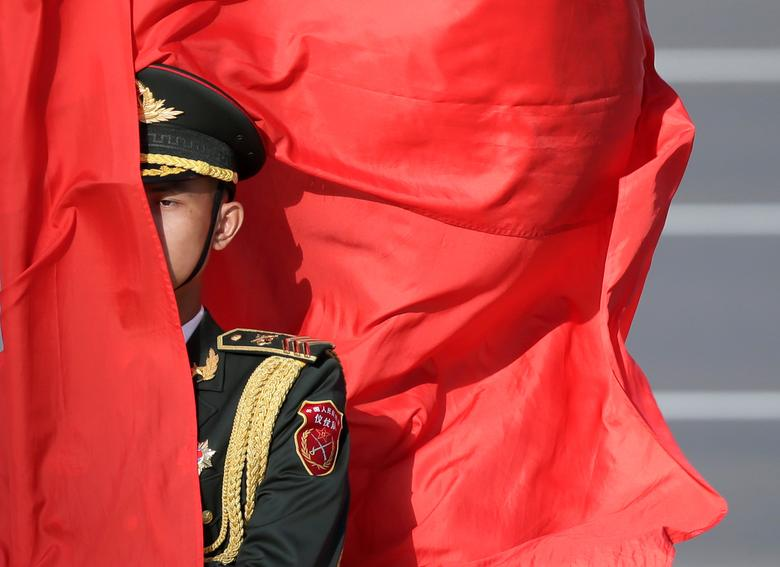 A soldier from honour guards holds a red flag during a welcoming ceremony for Vietnam's President Tran Dai Quang (not pictured) outside the Great Hall of the People, in Beijing, China May 11, 2017. REUTERS/Jason Lee