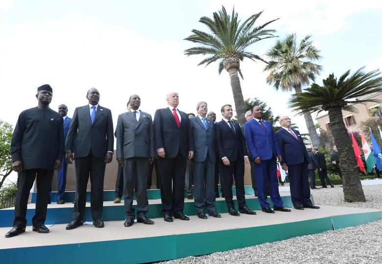 U.S President Donald Trump poses with G7 leaders and leaders of African nations during a family photo at the G7 Summit expanded session in Taormina, Sicily, Italy, May 27, 2017. REUTERS/Alessandro Bianchi
