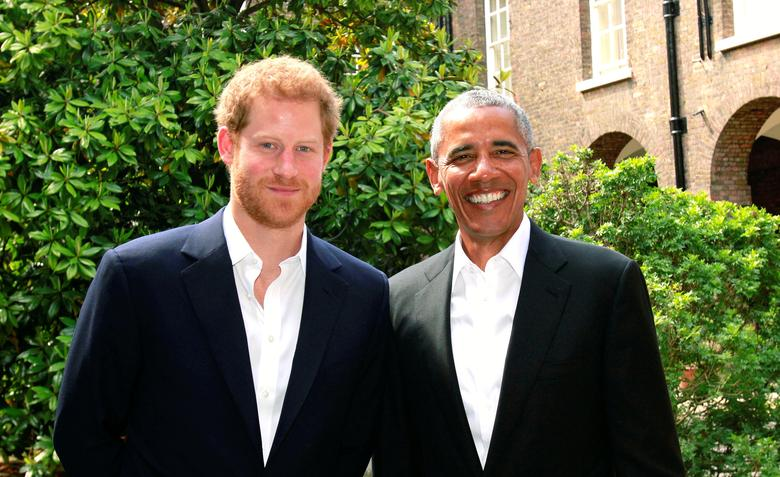 Britain's Prince Harry poses with former U.S. President Barack Obama following a meeting at Kensington Palace in a handout photo issued by Kensington Palace, in London, Britain May 27, 2017. Kensington Palace/Handout via REUTERS