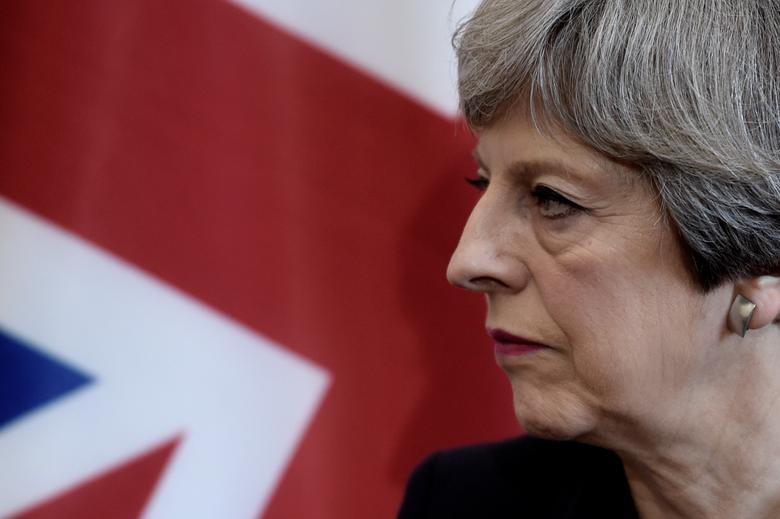 Britain's Prime Minister Theresa May listens to the French President during a bilateral meeting at the G7 Summit in Taormina, Sicily, May 26, 2017.  REUTERS/Stephane De Sakutin/Pool
