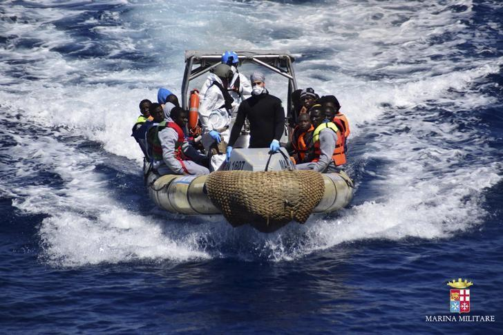 Migrants sit in a rescue boat during a rescue operation by Italian Navy vessels off the coast of Sicily in this April 11, 2016 handout picture provided by Marina Militare. REUTERS/Marina Militare/Handout via Reuters
