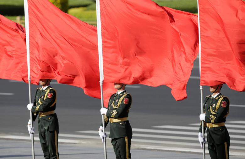 Soldiers from honour guards hold red flags during a welcoming ceremony for Vietnam's President Tran Dai Quang (not pictured) outside the Great Hall of the People, in Beijing, China May 11, 2017. REUTERS/Jason Lee