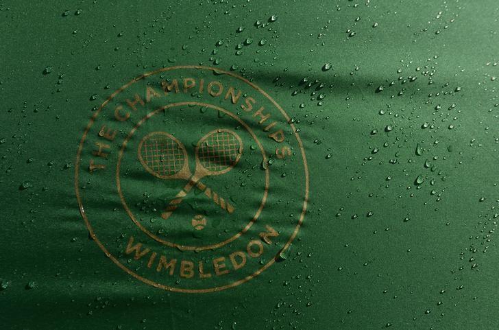 Britain Tennis - Wimbledon - All England Lawn Tennis & Croquet Club, Wimbledon, England - 2/7/16 General view of the Wimbledon logo on an umbrella as rain delays play REUTERS/Tony O'Brien/File Photo