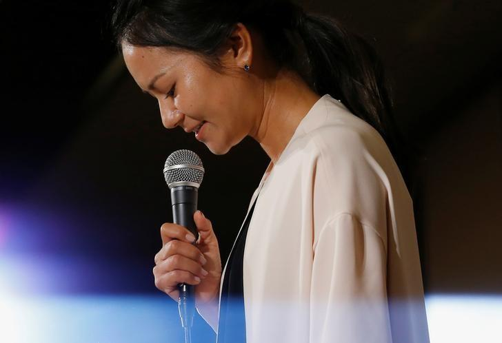 Former women's world number one golfer Ai Miyazato of Japan reacts as she attends a news conference to announce her retirement in Tokyo, Japan May 29, 2017. REUTERS/Issei Kato