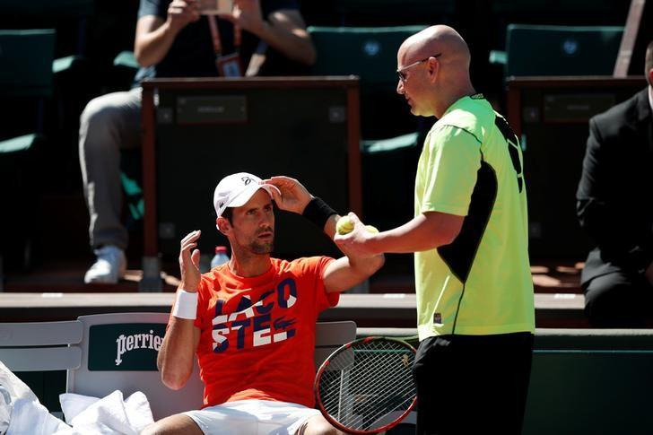 Tennis - French Open - Roland Garros - Paris - 26/05/2017 - Novak Djokovic of Serbia and his coach Andre Agassi attend a training session. REUTERS/Benoit Tessier