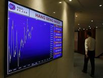 A screen displaying the Hang Seng Index is seen at the entrance to the Hong Kong Stock Exchange in Hong Kong October 28, 2014. China has yet to explain why the Hong Kong-Shanghai stock trading link-up missed its expected launch on Monday, but the landmark scheme to give investors in Hong Kong and the mainland direct access to each others' market had failed to reconcile critical tax differences. The Stock Connect scheme, considered a milestone in the liberalisation of China's capital markets, would allow global investors for the first time to trade China shares via Hong Kong, while giving mainland investors access to Hong Kong-listed stocks. REUTERS/Bobby Yip  (CHINA - Tags: POLITICS BUSINESS)
