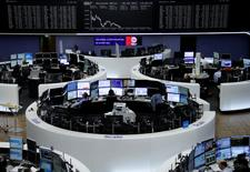 Traders work in front of the German share price index, DAX board, at the stock exchange in Frankfurt, Germany, May 26, 2017. REUTERS/Staff/Remote