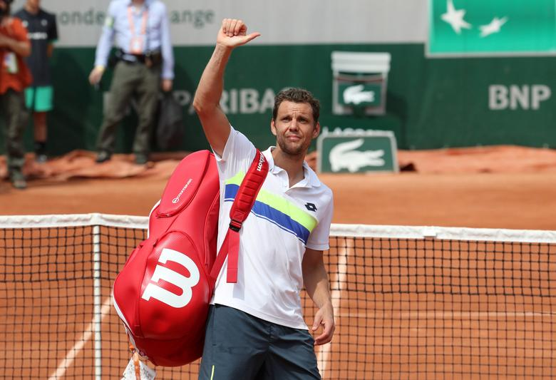 Tennis - French Open - Roland Garros, Paris, France - 29/5/17 France's Paul-Henri Mathieu gestures to fans as he looks dejected after losing his first round match against Belgium's David Goffin Reuters / Pascal Rossignol
