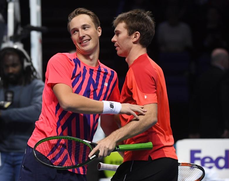 Barclays ATP World Tour Finals - O2 Arena, London - 20/11/16 Finland's Henri Kontinen and Australia's John Peers celebrate winning the doubles against South Africa's Raven Klaasen and USA's Rajeev Ram  Reuters / Toby Melville Livepic