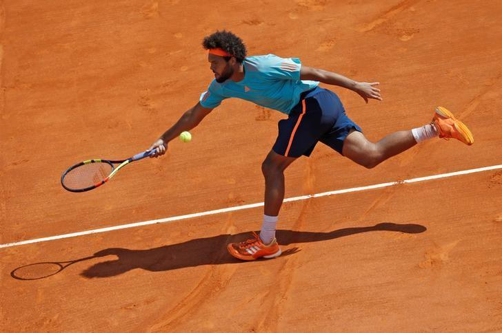 Tennis - Monte Carlo Masters - Monaco, 18/04/2017. Jo-Wilfried Tsonga of France plays a shot to his compatriot Adrian Mannarino.     REUTERS/Eric Gaillard/Files