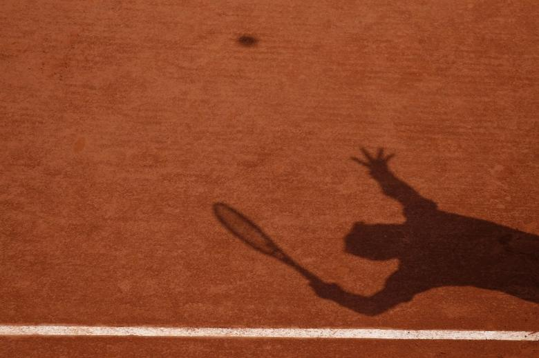 A French Open player serves