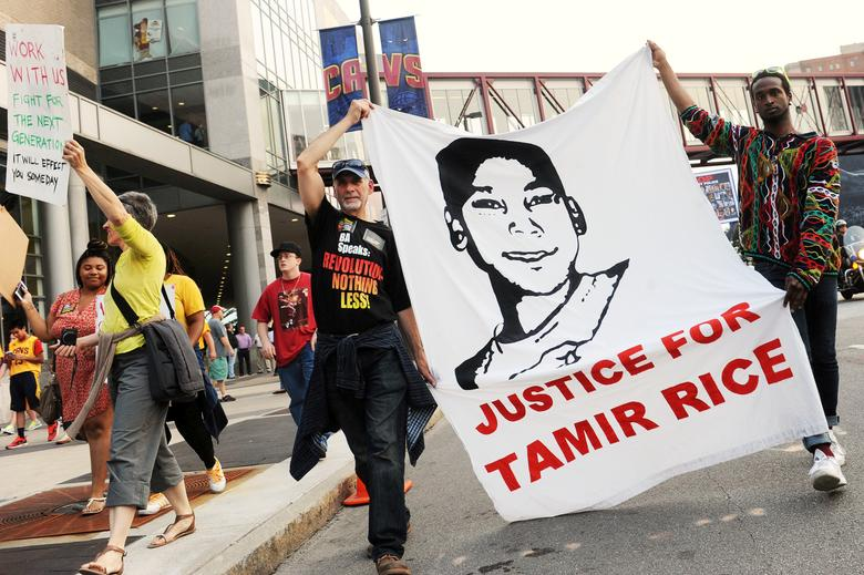 FILE PHOTO --  Jun 9, 2015; Cleveland, OH, USA; Tadar Muhammad (right) and Jeremy Brustein (left) demonstrate in support of Tamir Rice outside of Quicken Loans Arena prior to game three of the NBA Finals. Mandatory Credit: Ken Blaze-USA TODAY Sports/File Photo