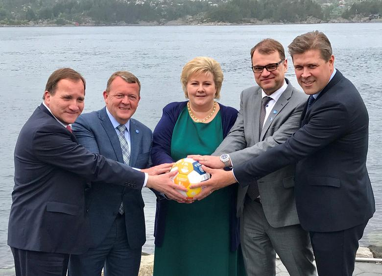 Sweden's Prime Minister Stefan Lofven (L-R), with his counterparts Lars Lokke Rasmussen of Denmark, Erna Solberg of Norway, Juha Sipila of Finland and Bjarni Benediktsson of Iceland hold a soccer ball during their meeting in Bergen, Norway May 29, 2017. Picture taken May 29, 2017. Prime Minister's Office/Handout via REUTERS