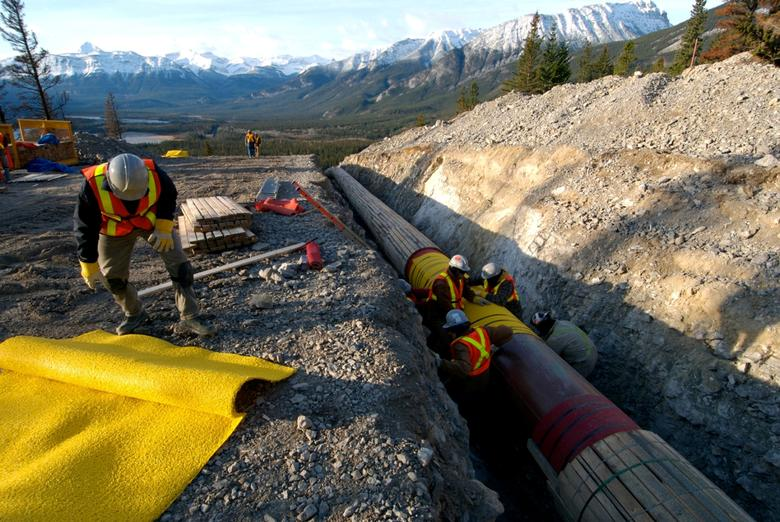 FILE PHOTO: Workers construct the Anchor Loop section of Kinder Morgan's Trans Mountain pipeline expansion in Jasper National Park in a 2009 file photo. Kinder Morgan Canada/Handout via REUTERS/File Photo