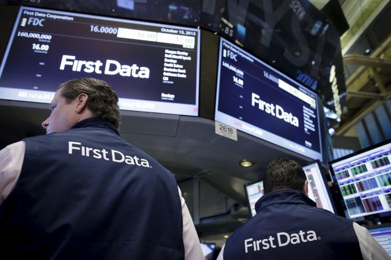 File photo: Traders work at the post that will trade First Data stocks during the company's initial public offering on the floor of the New York Stock Exchange October 15, 2015. REUTERS/Brendan McDermid