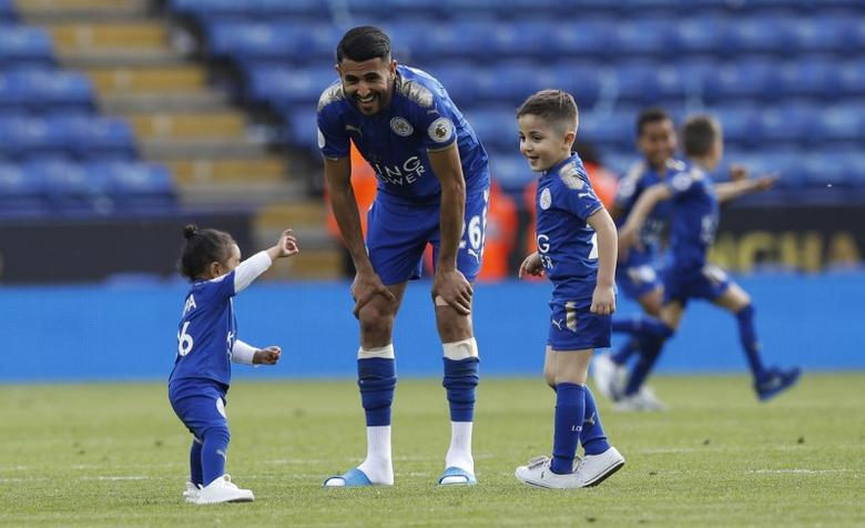 Britain Football Soccer - Leicester City v AFC Bournemouth - Premier League - King Power Stadium - 21/5/17 Leicester City's Riyad Mahrez with his family on the pitch after the match Reuters / Darren Staples Livepic