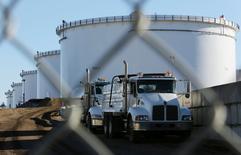 FILE PHOTO --  Dump trucks are parked near crude oil tanks at Kinder Morgan's North 40 terminal expansion construction project in Sherwood Park, near Edmonton, Alberta, Canada November 13, 2016.  REUTERS/Chris Helgren/File Photo