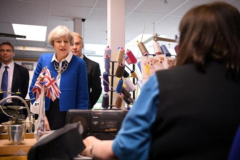 British Prime Minister, Theresa May visits Simon Jersey, a business uniform supplier in the Constituency of Hyndburn in Accrington, England, May 30, 2017. REUTERS/Leon Neal/Pool -